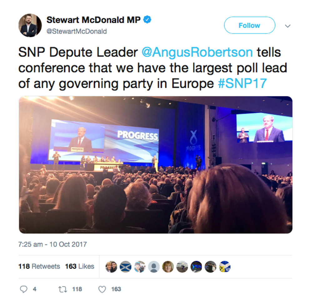 A tweet with a photo of a party conference.